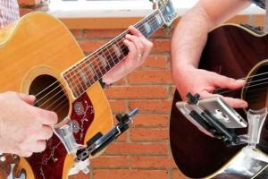 AcouStick: Smartphone Holder for Acoustic Guitars